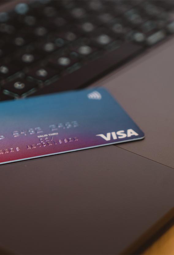 Closeup of Visa credit card on laptop.