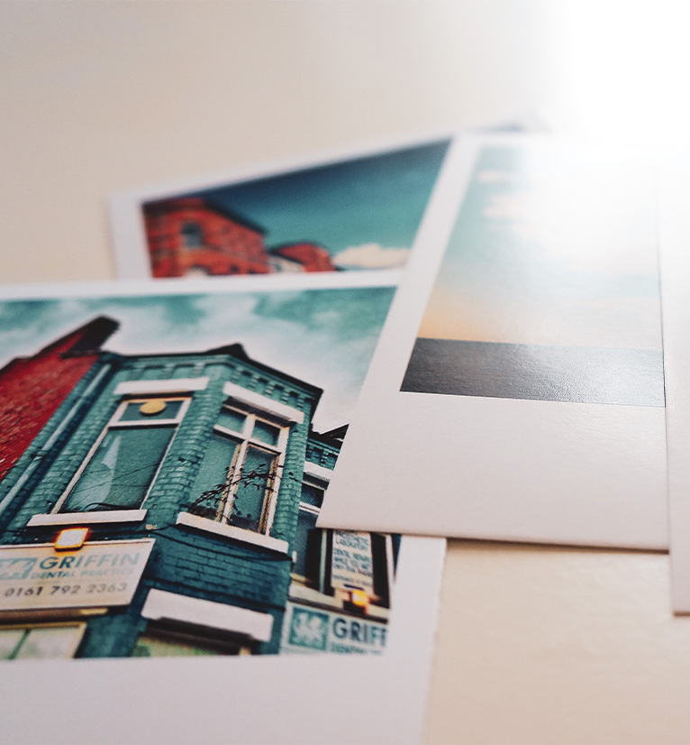Close up of printed photographs of brick buildings.