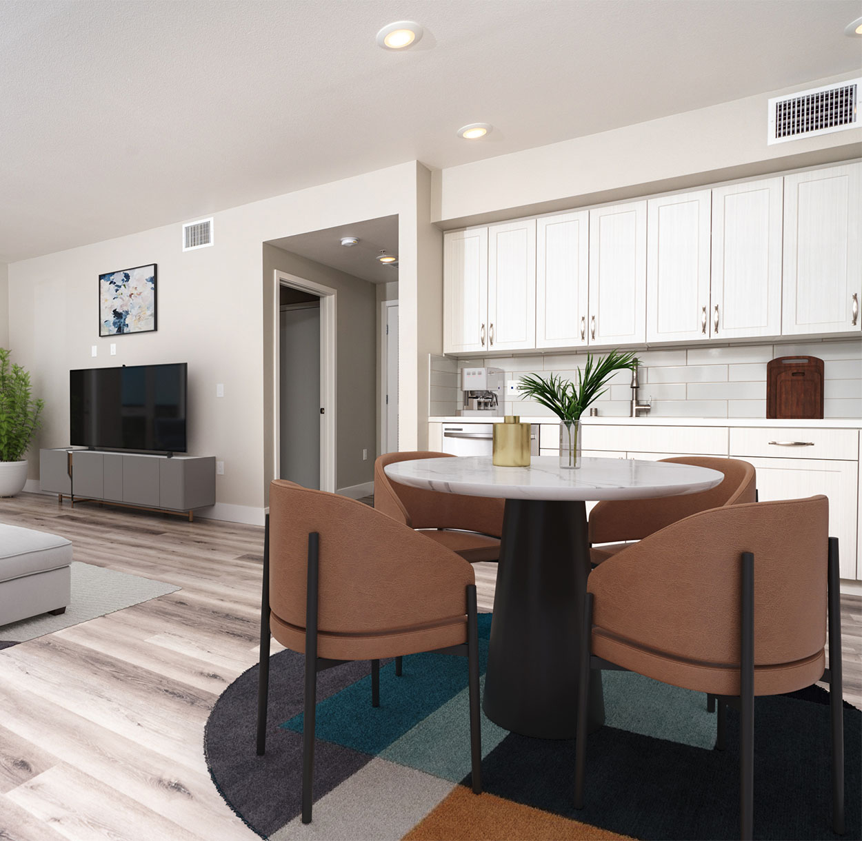 1250 Lakeside apartment living area with wood floor, white cabinets, geometric rug, and modern dining table.